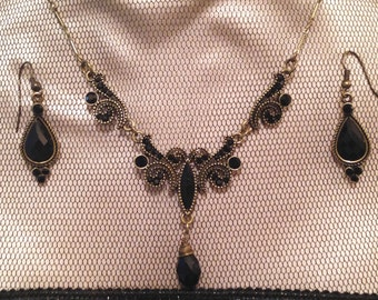 Gold Toned and Black Rhinestone Necklace and Earring Set
