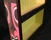 tiki mug display shelf pink tiki graphic