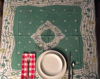 Novelty spring song tablecloth – post-war, features musical notes, treble clef, daffodil, daisy, tulip, springtime