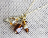 Brown & Gold Glass Bead Cluster Pendant with Gold Feather Charm | Swirled Caramel