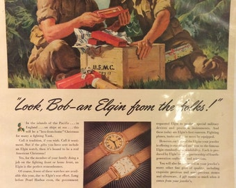 Circa 1942 war time ad for Elgin watches being dropped to the troops during WWII. 13x10. US Marines.