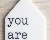 porcelain wall tag screenprinted text you are loved.