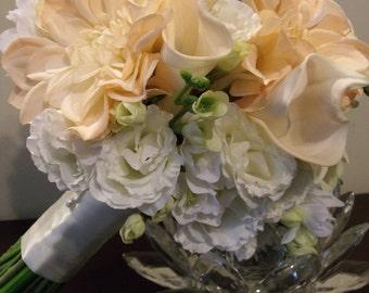 Peach, ivory and blue, Delphinium, dahlia, lisianthus, calla, freesia bouquet