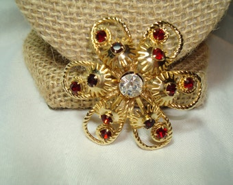 1960s Large Golden Flower Pin with Red Jewels.