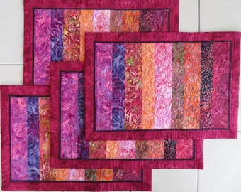 Quilted Batik Placemats set of four handmade fuchsia red purple peach pink