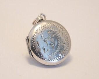 Vintage sterling silver locket.  Round locket