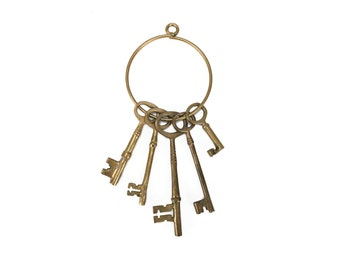 vintage oversized set of brass skeleton keys / jail keys