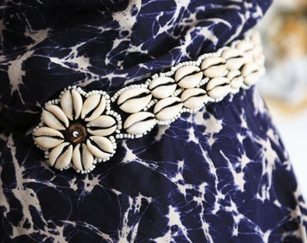 Shell and bead embellished textile belt.