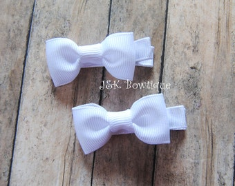 White solid color....Mini bow tie hair bow