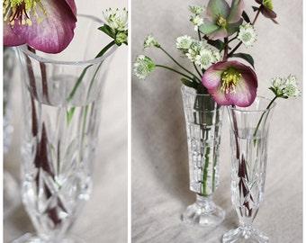 A set of 2 vintage cut glass bud vases