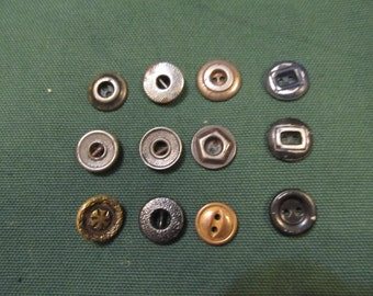 12 metal buttons - one has a shank back - lot #32