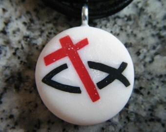 Fish and cross hand carved on a polymer clay white glitter color background.  Pendant comes with a FREE 3mm necklace