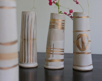 white and gold bud vases