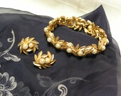 Vintage Avon faux pearl buds on gold tone leaf vine bracelet and clip earrings