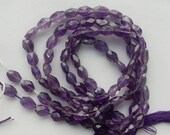 Amethyst faceted  irregular oval beads (7-10x6-7mm)  Hand cut, full strand