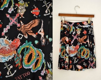 Vintage Silk Wrap Skirt Size Small With Tattoo Print by Nicole Miller//  Vintage Pleated Skirt in Silk with tattoo Skulls dragon print