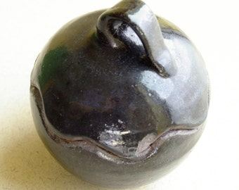 Dark round bird jar