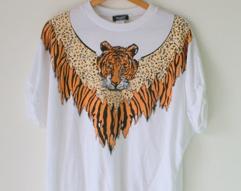 Vintage 1980s EYE of the TIGER....size medium womens..retro. funky. twiggy. disco. shirt. top. blouse. 1980s 1990s clothing. animal