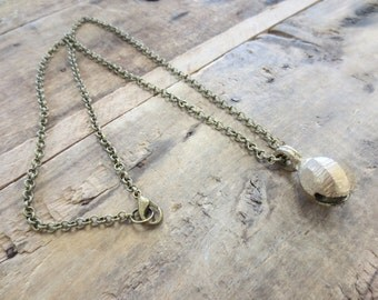Raw brass bell pendant necklace