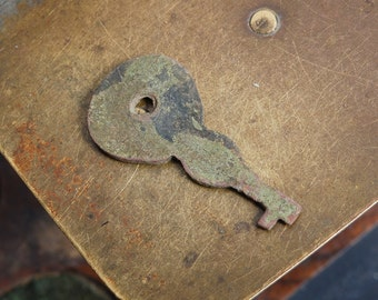 Antique miniature brass primitive skeleton key. Dark patina