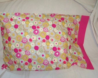 1 single pillow case- bright pink with colorful circles! Nice!