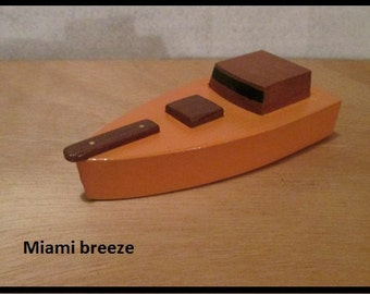 Little wooden toy boat