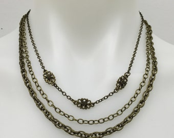 CA Multiple Chain Layers Statement Necklace w/3 Flowers Detail