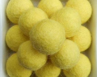 20 wool felt balls 2cm yellow