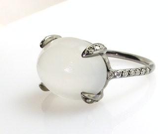 White moonstone ring.