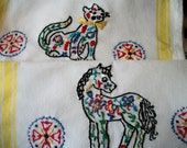 Hand embroidered set of two kitchen towels, cat and horse folk art motif, yellow stripes.