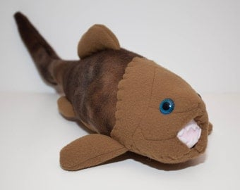 Extinct Dunkleosteus Fossil Plush in Browns