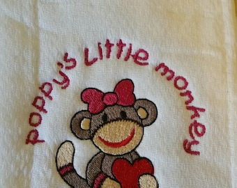 Embroidered Burp Cloth with a Sock Monkey design that says Poppy's Little Monkey (but can say ANYONE'S Little Monkey)