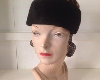 Vintage 1950s inky black pillbox hat with leopard print fur trim