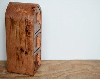 Tall wooden box. Wood grain. secret drawer. hidden compartment.  leather pulls. bandsaw box