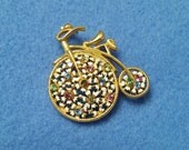 Vintage Penny Farthing Bicycle Goldtone Brooch Pin with Pastel Crystals and White Enamel