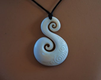 Maori Koru ,friendship pendant. Hand carved in bone and engraved 1 & 6/8 inch long