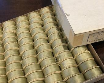 Vintage paper bobbins new old stock 83 yards set of 12 light olive green color