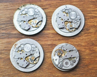0.7 inch Set of 4 vintage watch movements with dial.