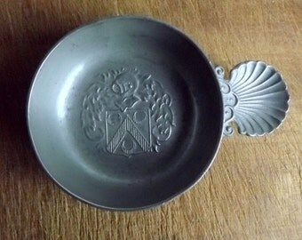 Pewter tastevin, trinket dish, with coat of arms, and shell thumb rest