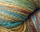 Handspun, hand dyed yarn. 50/50 silk and organic wool.  Golds, fuchsia, pinks, pale greens, turquoise and grey. 840 yards.
