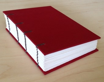 Red coptic journal with blank pages