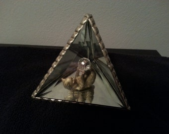 Beveled glass pyramid with cat and crystal ball