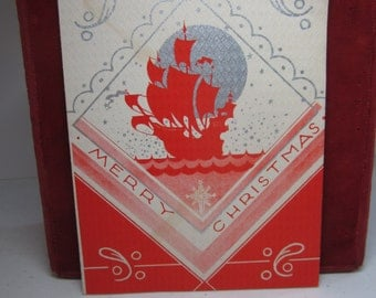 1936 colorful silver gilded art deco christmas card red silhouette of a sailing ship silver moon