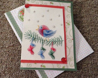 Stitched Christmas card of bird and stockings with envelope.