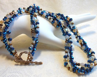 Sparkly blue and gold crystal necklace, twisted three strand necklace, holiday necklace, bronze toggle closure, opalite crystals