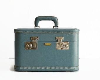 vintage blue train makeup case with key suitcase 1950s luggage