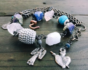 Raw stone, lapis and Milagros bracelet necklace | blue lapis bracelet, raw Quartz bracelet, Milagros charms, Rustic assemblage
