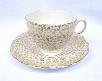 Colclough English Bone China Cup and Saucer set, White with Gold Stars and Snowflakes, 64331