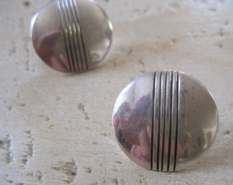 Sterling silver round earrings made by Thomas and Kathy Lee