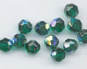 24 gorgeous Swarovski crystals - art 5000 - 6 mm - emerald AB